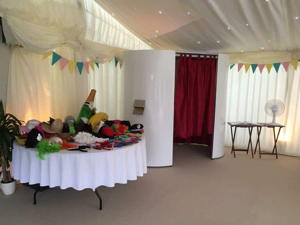 White Photo Booth at Event With Props